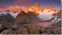 Argentina, Santa Cruz, Los Glaciares National Park, Alpenglow illuminates Mount Fitz Roy (11,073ft/3,375m), Aguja Poincenot, and Aguja Saint Exupery above Laguna de los Tres